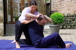 Twisting of the spine as part of a Thai body massage